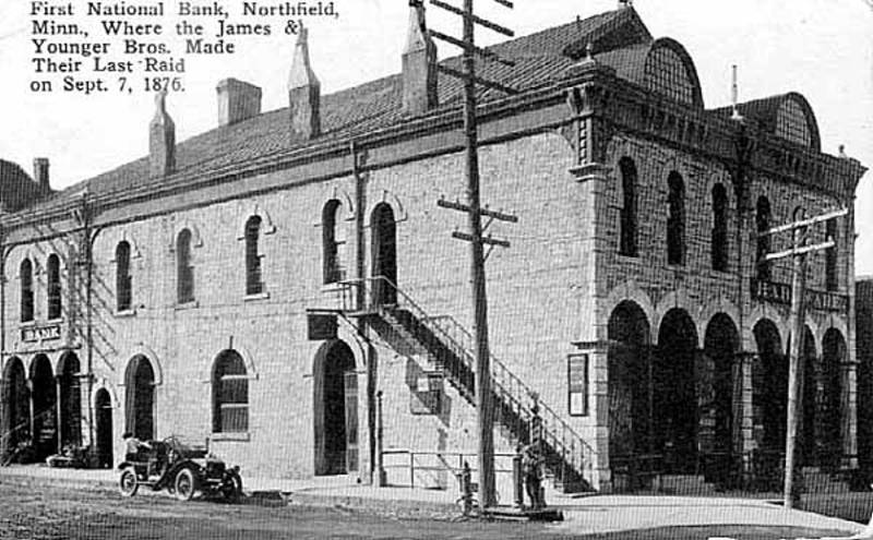 Balck and white image of the two story First National Bank