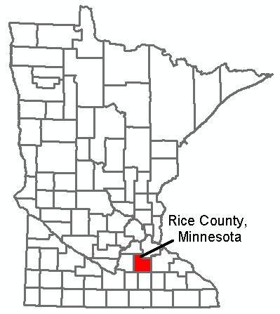 Black and white outlined map of Minnesota depicting the counties, Rice County is red.