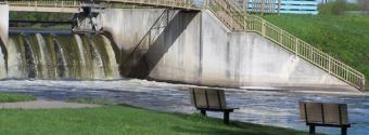 Image of benches in front of a water dam in King Mill Park