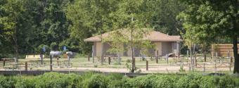 Image of an outbuilding and park benches in McCullough Park and Campground
