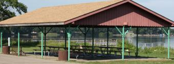 Image of veranda shelter with picnic tables in Shager Park