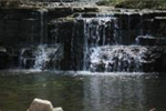 Image of rocky waterfall and pond in Caron Park