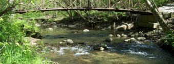 Image of small footbridge and rocky creek in Falls Creek Park