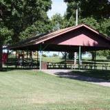Image of the front of the picnic pavilion with tables