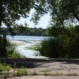 Image of cement easement into the lake, with trees