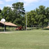 Image of the picnic pavilion, slide, and basketball court.