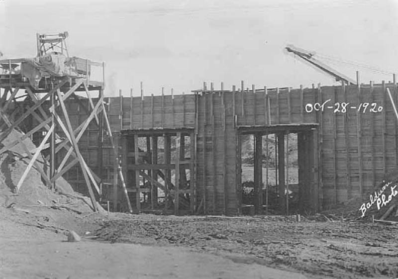 Black and white photo of the Faribault to Northfield bridge under construction circa 1920