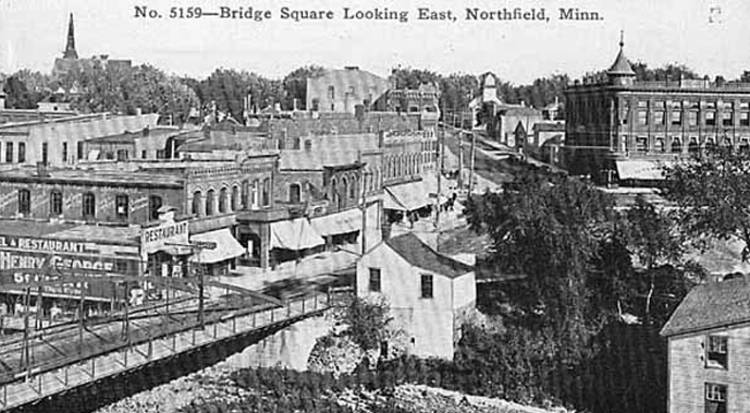 Black and white image of Bridge square looking east, with buildings and a street