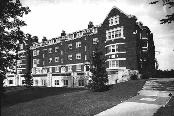 Black and white image of the five story brick Carleton College Evans Hall in 1942