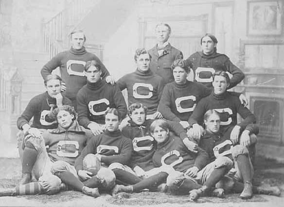 Black and white image of the thirteen men of the Carleton Football team in 1897 wearing jerseys