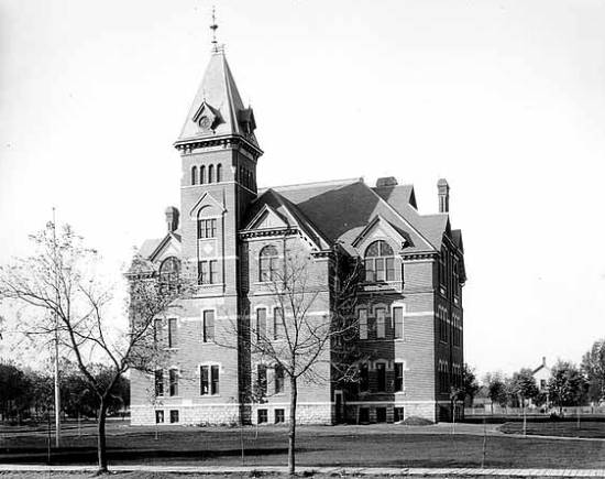Black and white image of the five story Faribault High School in1892