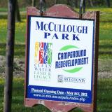 Image of the white McCullough Park Sign