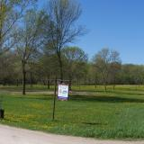 Image of a trail and the meadow in McCullough park