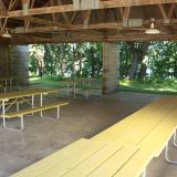 Image of the picnic pavilion's interior with tables