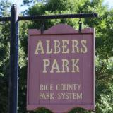 Image of the brown Albers park sign with yellow lettering